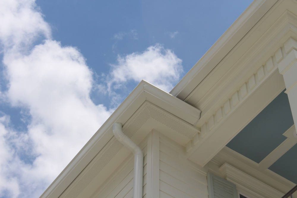Dentil molding and round gutters on New Orleans home - Strong Shield