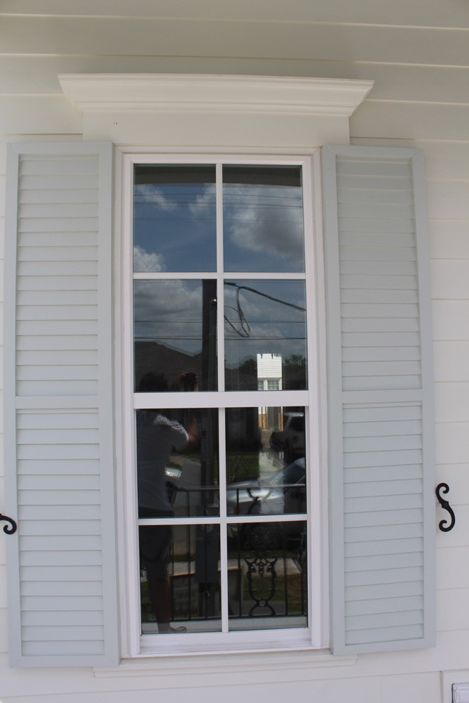 Craftsman style window trim and louvered panel shutters - Strong Shield