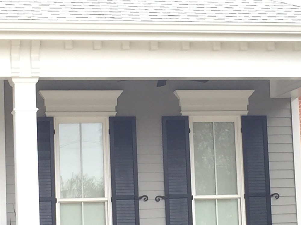 Louvered panel shutters with iron holdbacks - Strong Shield