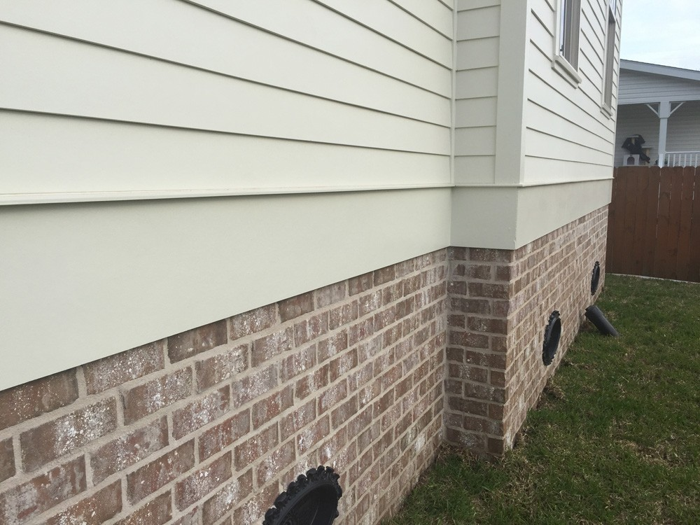 Trim between hardie siding and brick foundation - Strong Shield