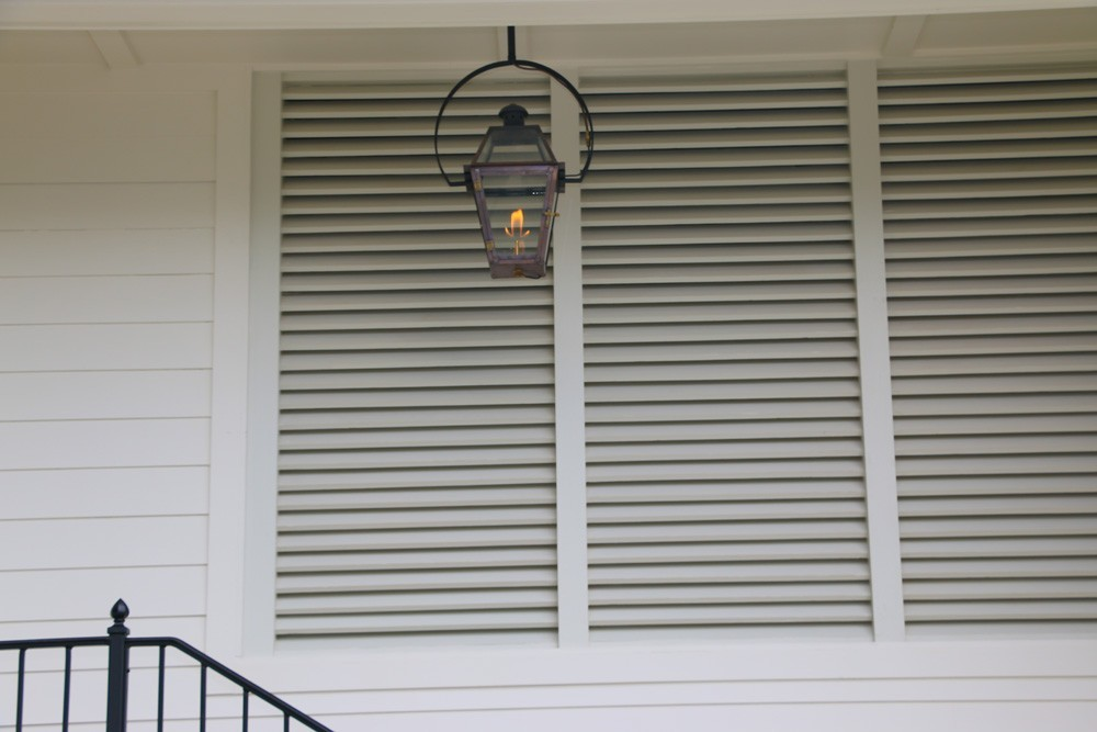 Louvered style shutters on front porch - Strong Shield