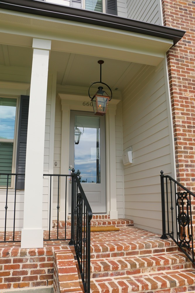 Iron railing and craftsman columns - Strong Shield