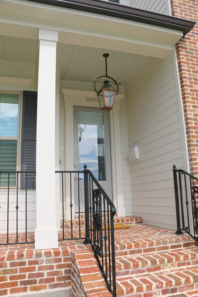 Iron railing, craftsman columns and trim on Metairie home - Strong Shield