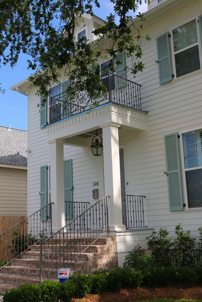 Iron railing, large craftsman columns, dentil molding - Strong Shield