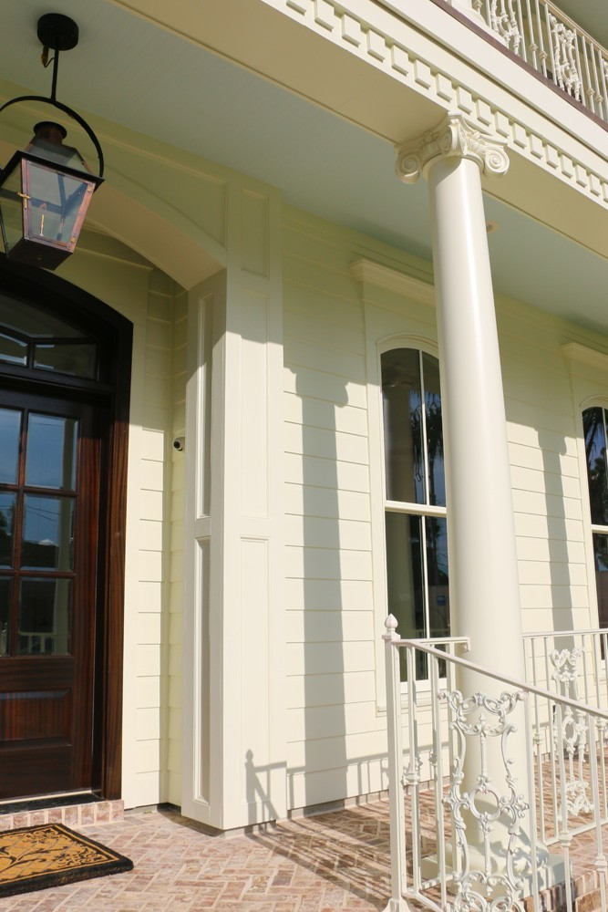 White iron railing, round tapered columns with grecian molding - Strong Shield