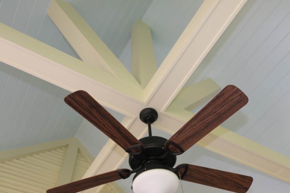 Ceiling fan mounted on cathedral porch ceiling beams - Strong Shield