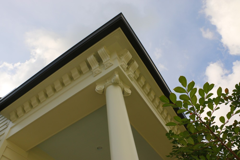 Intricate crowning trim pieces below porch soffits - Strong Shield