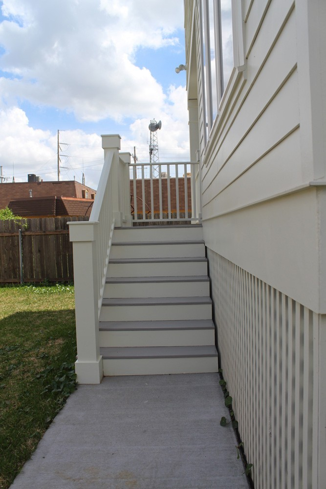 Craftsman style hand rail on hardie home - Strong Shield