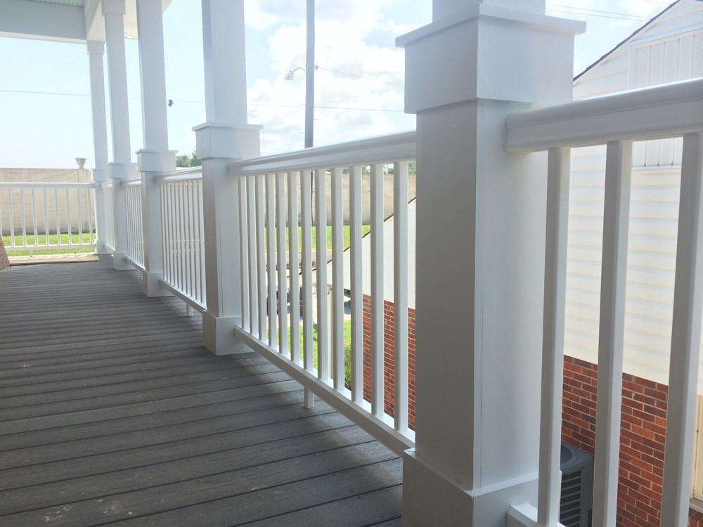 Craftsman columns and railing on New Orleans home balcony - Strong Shield