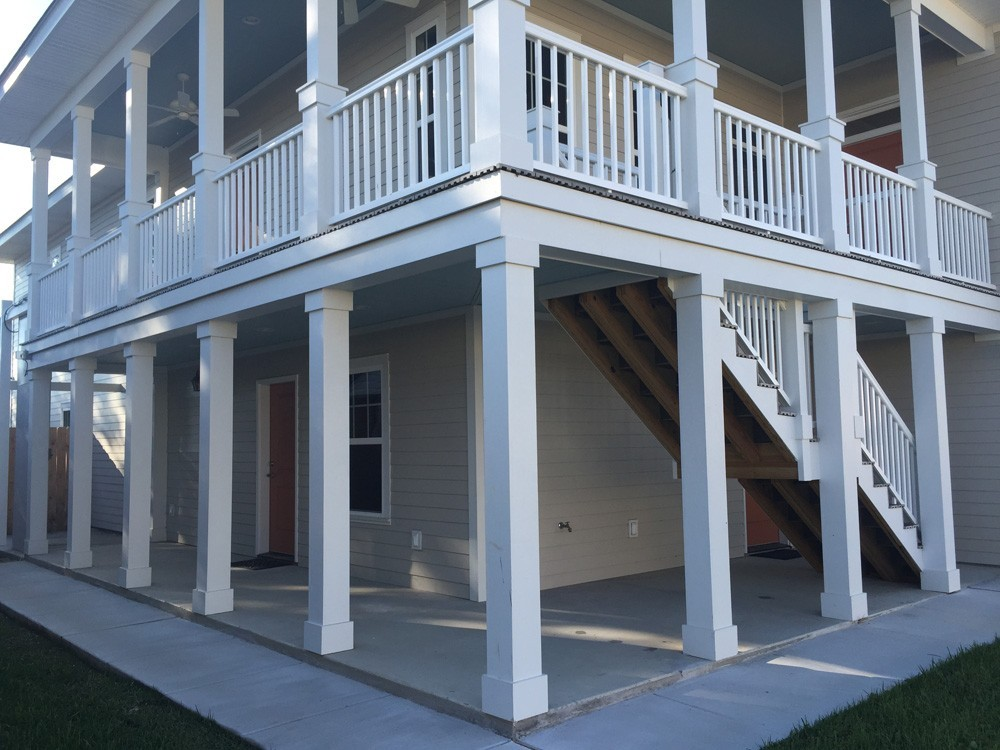 Columns and railing on two story New Orleans home - Strong Shield